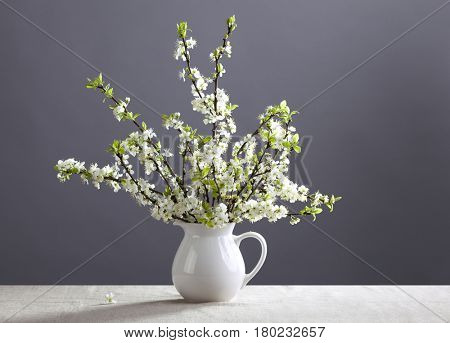 White flowers in the white jug