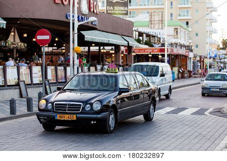 PROTARAS, CYPRUS - 10 OCT 2016: Taxi cars on the street