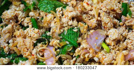 Chopped meat with chopped vegetables and chilies. Spicy minced pork salad.