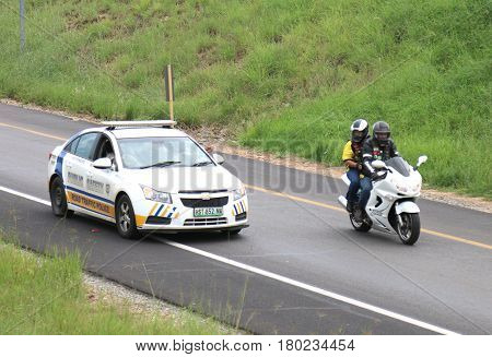 Guide Traffic Police Car Giving Biker Right Of Way To Freeway