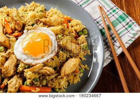 Fried Rice Nasi Goreng With Chicken Egg And Vegetables On A Plat