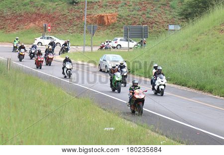 Long Line Of Motorbikes Travelling Onto Freeway Onramp