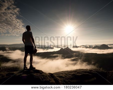 Man At The Top Of A Mountain Looking The Misty Landscape. Feel Free