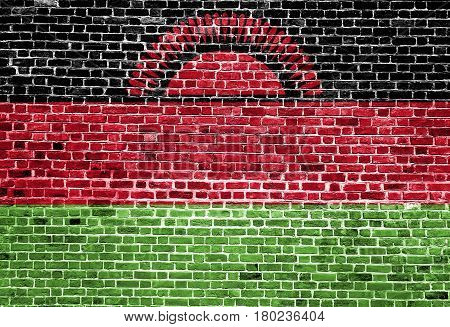 Flag of Malawi painted on brick wall, background texture
