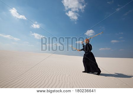 Concentrated Man Is Practicing Martial Arts In A Desert