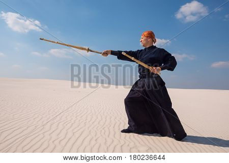Resolute Man With A Training Sword Is Practicing Martial Arts