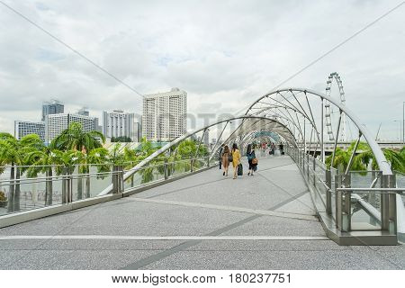 MARINA BAY SINGAPORE - JAN 20 2017: Landscape of Helix Bridge nearly to The Marina Bay Sands. Helix Bridge is a famous scene of Singapore travel destination.