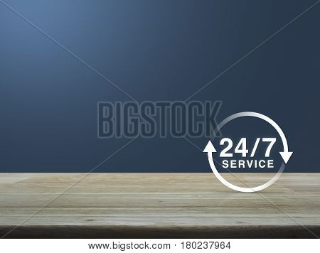24 hours service icon on wooden table over light blue gradient background Full time service concept