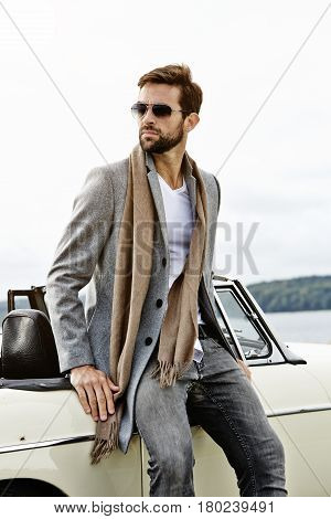 Vintage car and cool guy looking away