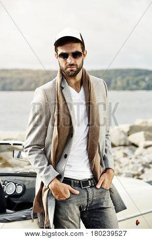 Man in cap and shades looking at camera