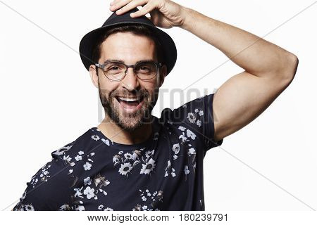 Man in trilby and spectacles portrait studio shot