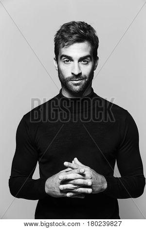 Hands clasped guy in studio portrait studio shot