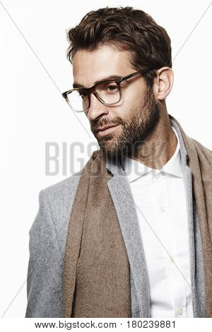 Scarf and spectacles man in studio studio shot