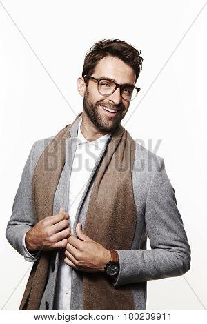 Smart guy in studio smiling studio shot