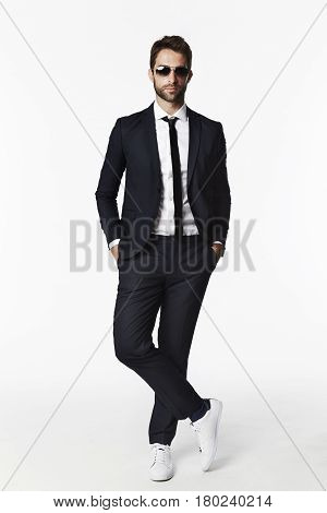 Portrait of businessman in shades studio shot