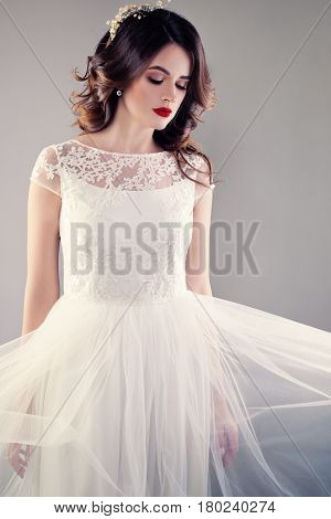 Beautiful Bride in White Wedding Gown Young Fiancee with Perfect Hairstyl and Makeup
