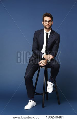 Portrait of smart man in suit studio