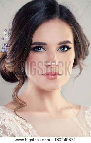 Closeup Portrait of Beautiful Bride Wearing Fashion Wedding Dress with Luxury Makeup and Hairstyle Studio Photo. Young Attractive Model