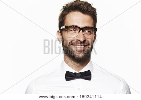 Smiling man in shirt and bow tie