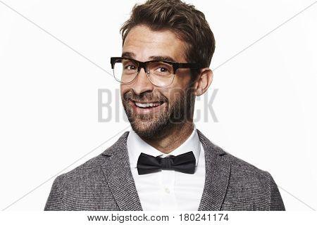 Smiling geek guy in bow tie portrait