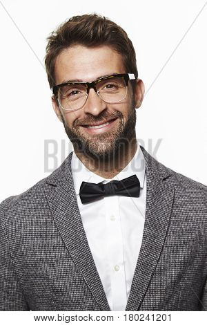 Smiling guy in bow tie portrait studio shot
