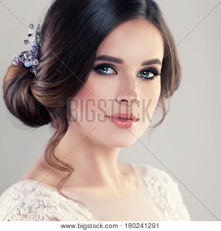 Young Woman Fiancee with Bridal Hairstyle Natural Makeup and Jewelry
