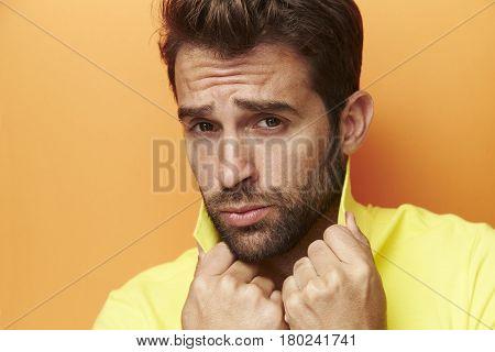 Posing guy in yellow portrait studio shot