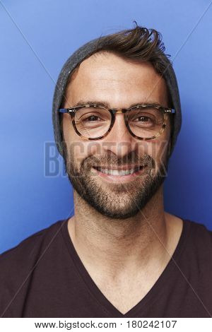 Portrait of man in hat and spectacles
