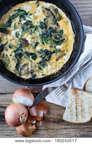 Omelette with wild mushrooms and spinach view from above