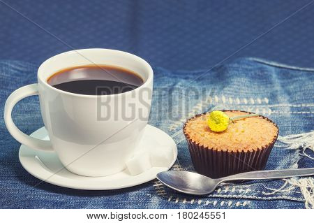 Hot Fresh Coffee In White Cup And Soft Cake On Blue Jeans On Table.coffee Break. Relax Times. Vintag