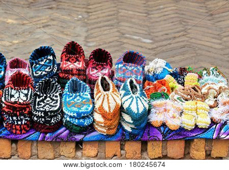 Knitted handmade souvenir shoes of bright colors for sale