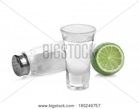 Tequila shot with juicy lime and salt on white background