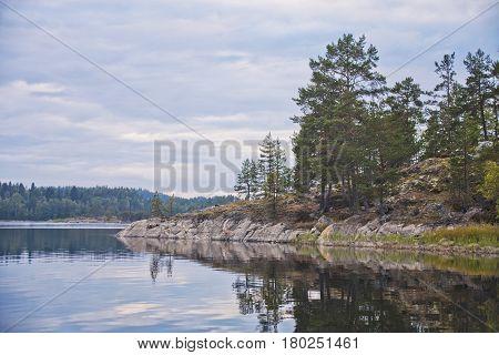 Lake Ladoga Republic of Karelia Russia. Evening autumn landscape