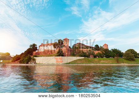 A beautiful view of the Wawel Castle from the Vistula River on a sunny day at sunset. Cracow, Poland.