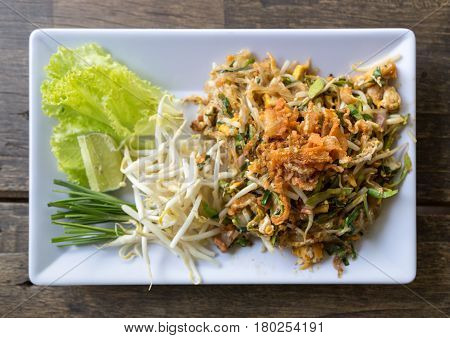 pad thai or the thai style noodle on wood table top view