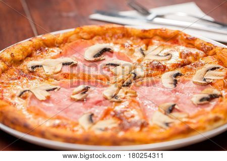 Close Up Of Pizza With Ham And Mushrooms