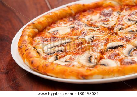 close up of pizza mushrooms on a wooden table