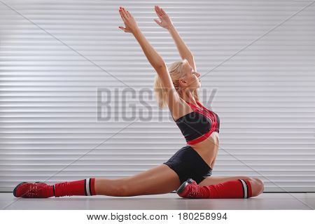 Horizontal shot of a young sportswoman in workout clothing practicing yoga doing stretching exercises sitting on the floor copyspace healthcare lifestyle people sports recreation body flexibility.