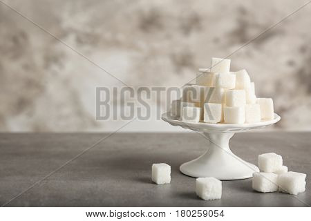 Vintage stand with sugar cubes on table
