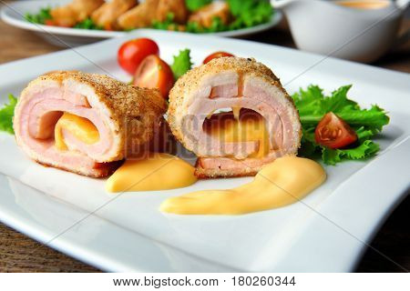 Plate with tasty chicken sliced roll, closeup