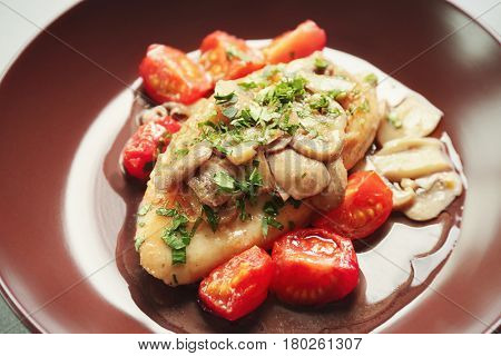 Tasty chicken marsala with mushrooms and tomatoes, closeup