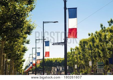 French flags along the road in Perpignan France