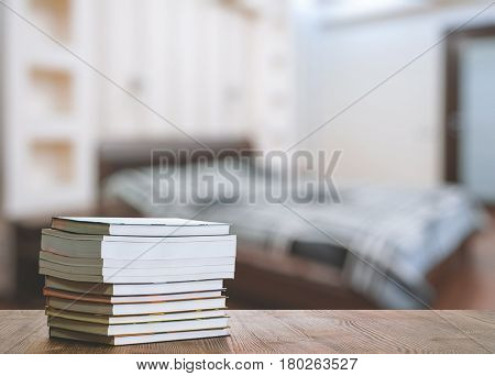 books on old wooden table in the bedroom
