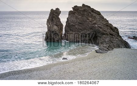 The famous standalone cliff in the beach of Monterosso (Cinque Terre UNESCO Site, Liguria, Northern Italy).