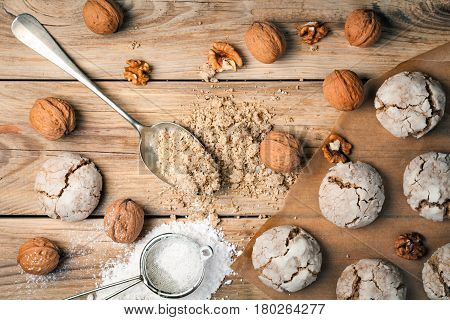 Cracked nut cookies on wood background. Top view
