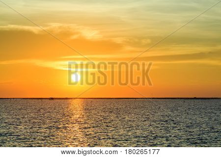 Sunset and orange sky over the sea in Thailand
