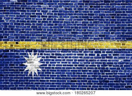 Flag of Nauru painted on brick wall, background texture