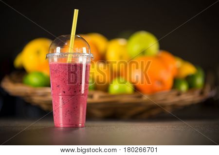 Fresh Red Smoothie With Fruits On The Background