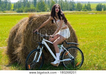 attractive woman cycling in the field outdoors