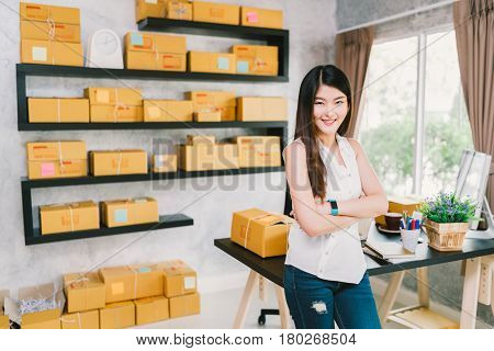 Young Asian small business owner at home office online marketing packaging and delivery scene startup SME entrepreneur or freelance woman working at home concept